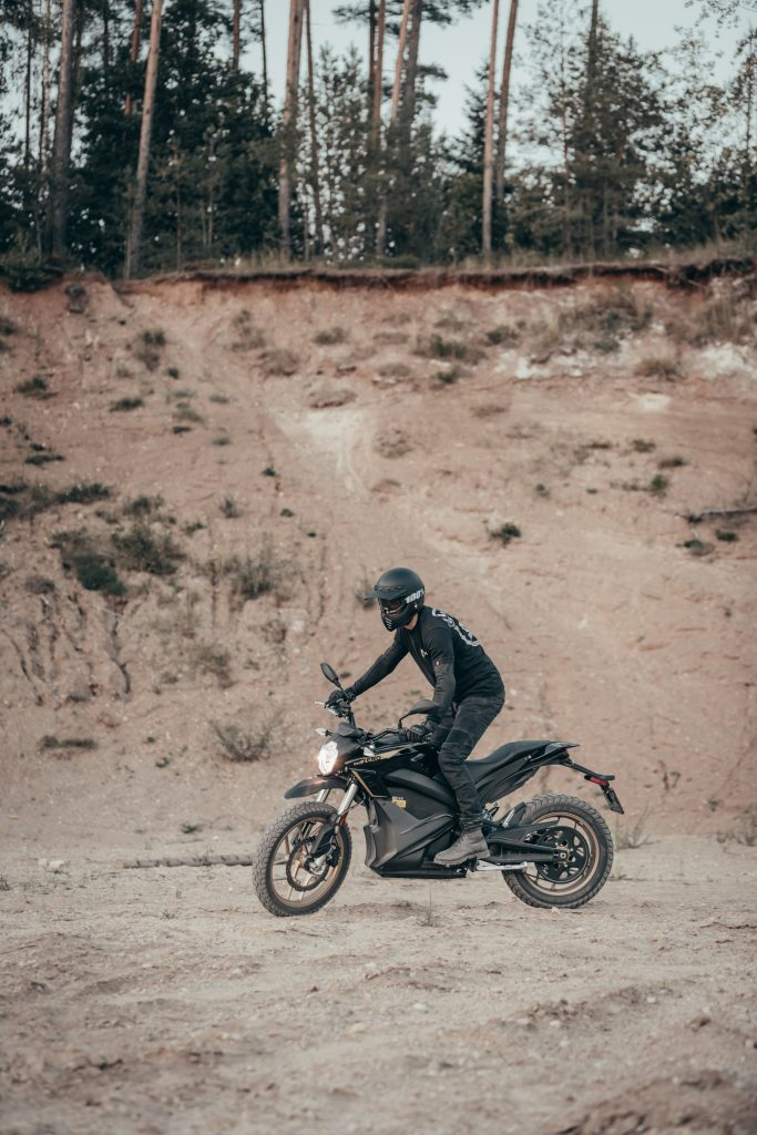 A motorcyclist in Dyneema jeans riding his dirt bike