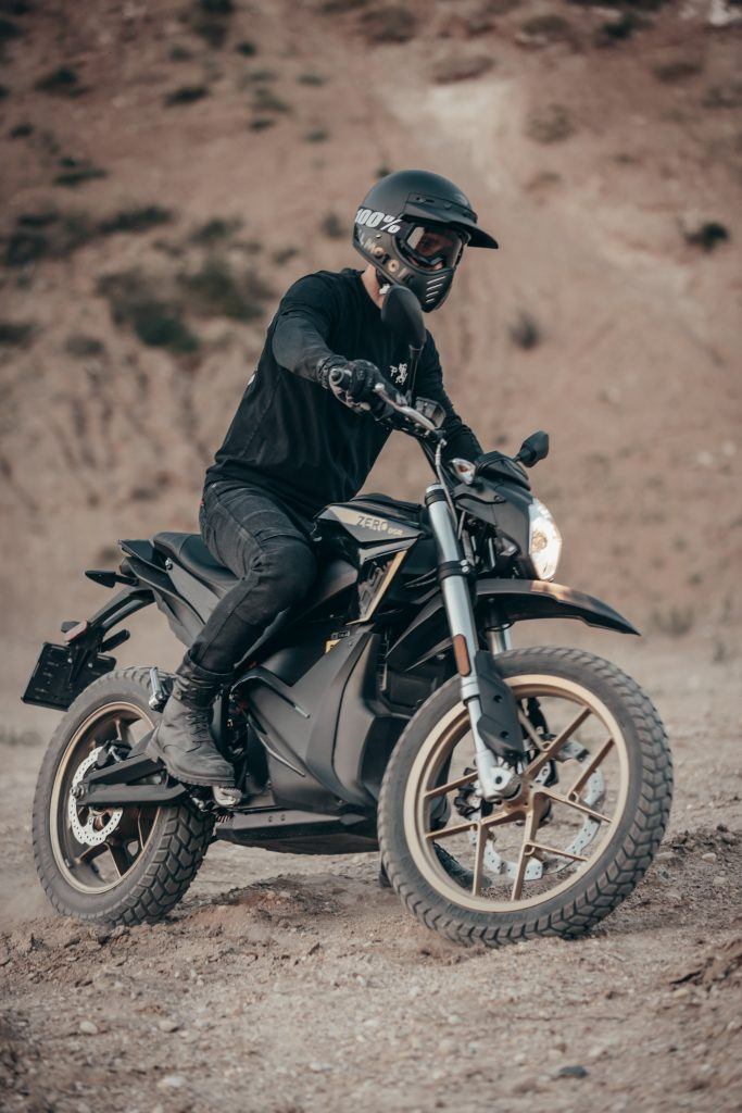 A motorcyclist in Dyneema jeans turning his dirt bike