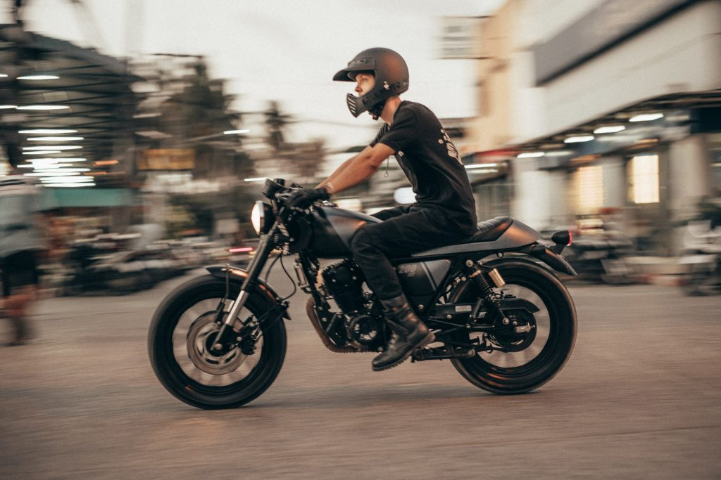 A happy biker in his jeans with Coolmax technology